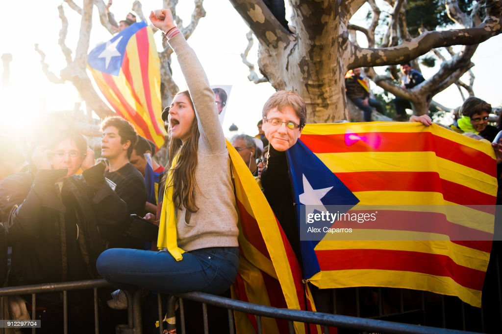 Demonstrators take part in a protest to support former Catalan President, Carles Puigdemont in front of the Parliament of Catalonia on January 30, 2018 in Barcelona, Spain. The President of the Parliament of Catalonia, Roger Torrent has called off the parliamentary session scheduled for today to form a new regional government. The Spanish Constitutional Court ruled on Saturday that Carles Puigdemont, who was proposed by the pro-independence parties as the candidate to be the new President of Catalonia, has to be present to be elected as the new region's President. Carles Puigdemont, who fled Spain for Belgium to avoid arrest for leading a secession bid, is facing possible charges of rebellion, sedition and misuse of public funds and faces arrest if he returns from Brussels.