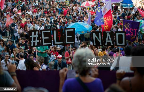 Demonstrators take part in a protesto against Brazilian rightwing presidential candidate Jair Bolsonaro called by a social media campaign under the...
