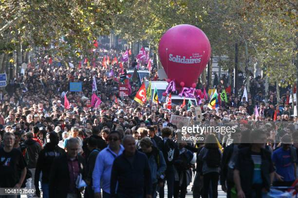 Demonstrators take part in a rally called by several French workers unions on October 9 2018 in Paris as part of a nationwide day of demonstrations...