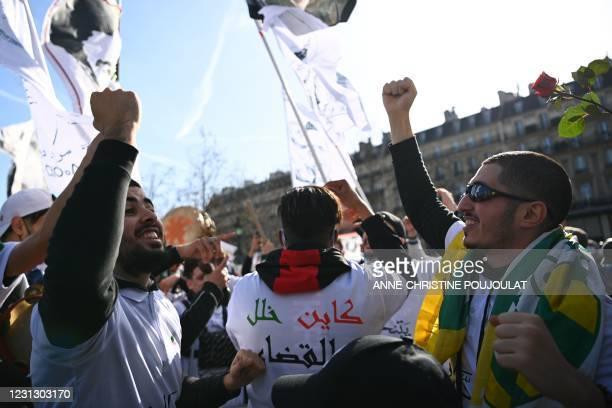 Demonstrators take part in a rally in Paris on February 21 in support of the Hirak anti-government movement in Algeria. - The Hirak protest movement,...