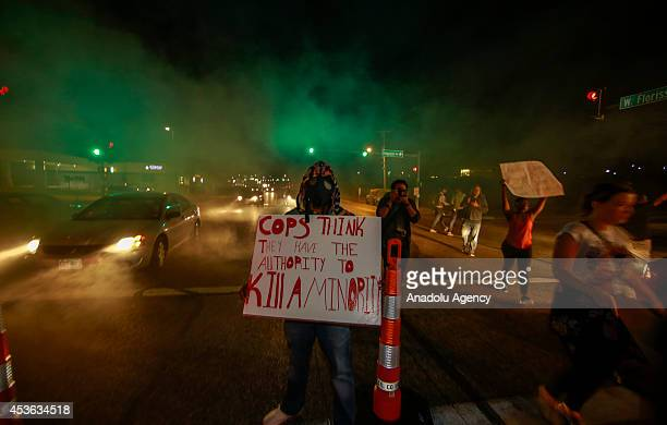 Demonstrators take part in a rally on West Florissant Avenue to protest the shooting death of an unarmed teen by a police officer in Ferguson...