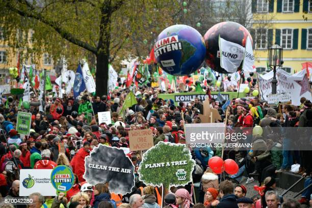 Demonstrators take part in a socalled Climate March against fossilbased energy like coal on November 4 2017 in Bonn western Germany The western city...