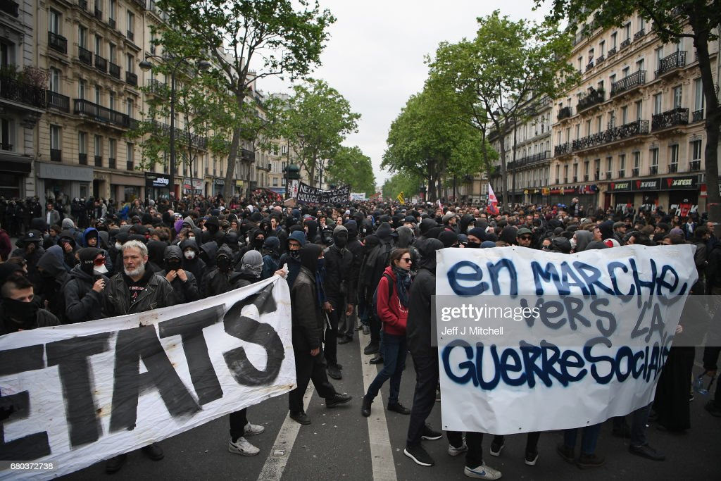 Demonstrators take part in a trade unions demonstrations against the election of Emmanuel Marcon on May 8, 2017 in Paris, France. The centrist candidate Mr Marcon defeated far right candidate Marine le Pen in yesterday's run off for the French presidency.
