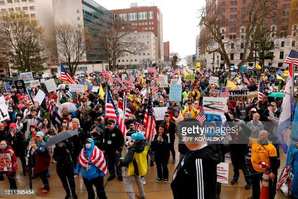 Demonstrators take part in an American Patriot Rally organized on April 30 by Michigan United for Liberty on the steps of the Michigan State Capitol...