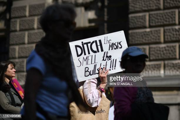 Demonstrators take part in an anti-lockdown, anti-Covid-19 vaccination passports, 'Unite for Freedom' protest in central London on April 24, 2021.