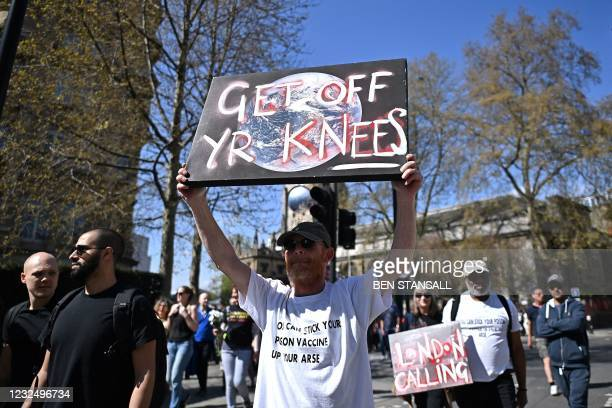 Demonstrators take part in an anti-lockdown, anti-Covid-19 vaccination passport, 'Unite for Freedom' protest in central London on April 24, 2021.