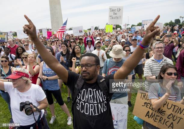 Demonstrators take part in the March for Truth rally on the National Mall in Washington, DC, on June 3, 2017. Sharp political passions over US...