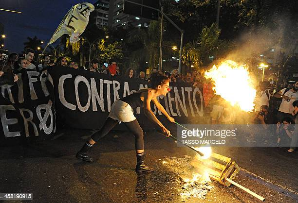 Demonstrators takes part in a protest against a public transport fare hike announced for January 2014 by Rio de Janeiro's Mayor Eduardo Paes, in...