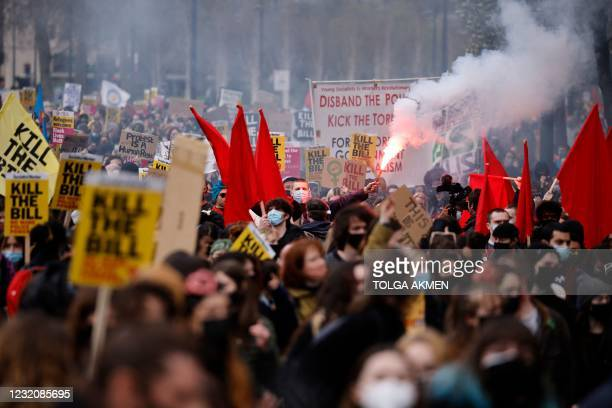 Demonstrators taking part in a 'Kill The Bill' protest against the Government's Police, Crime, Sentencing and Courts Bill hold up placards as they...
