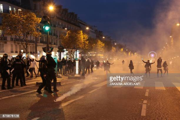 Demonstrators taking part in a march against 'slavery in Libya' on the ChampsElysees avenue face antiriot police in Paris on November 18 2017 / AFP...