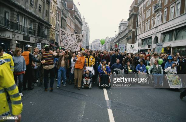 Demonstrators taking part in a rally to promote the legalisation of cannabis in London 6th May 2000