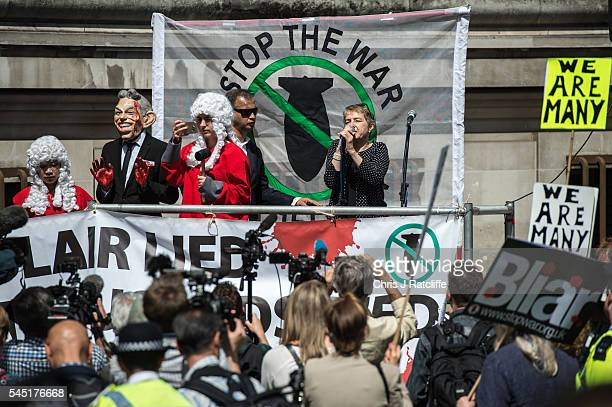 Demonstrators talk on a podium outside the Queen Elizabeth II conference centre on July 6, 2016 in London, England. The Iraq Inquiry Report into the...