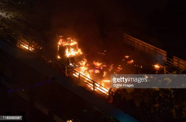 Demonstrators throw Molotov cocktails at the police armoured vehicle during the protests Siege at Polytechnic University Police surround the...