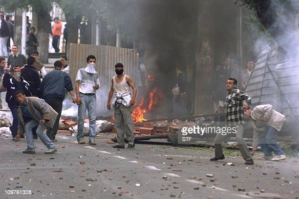 Demonstrators throw stone at security forces in Tizi Ouzou 140 km south of Algiers 28 April 2001 Renewed riots broke out today in Algeria's...