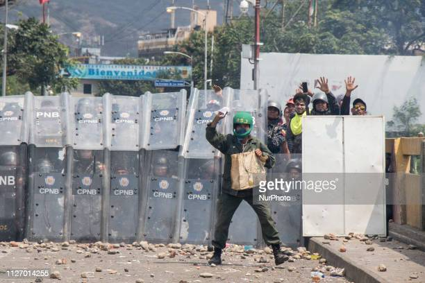 Demonstrators throw stones in clashes with the security forces at the Francisco de Paula Santander international bridge Bridge linking Cucuta...