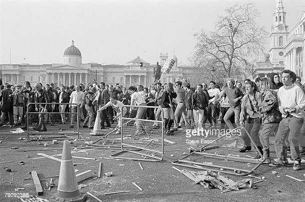 Demonstrators throwing missiles at police in Trafalgar Square during rioting which arose from a demonstration against the Poll Tax London 31st March...