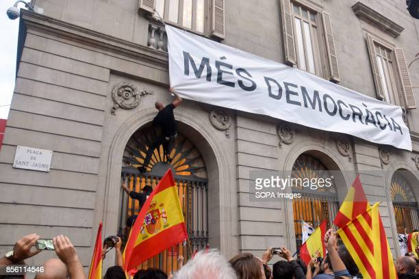Demonstrators trying to break a banner of the Barcelona City Council with the slogan more democracy About 5500 according to the Guardia Urbana and...