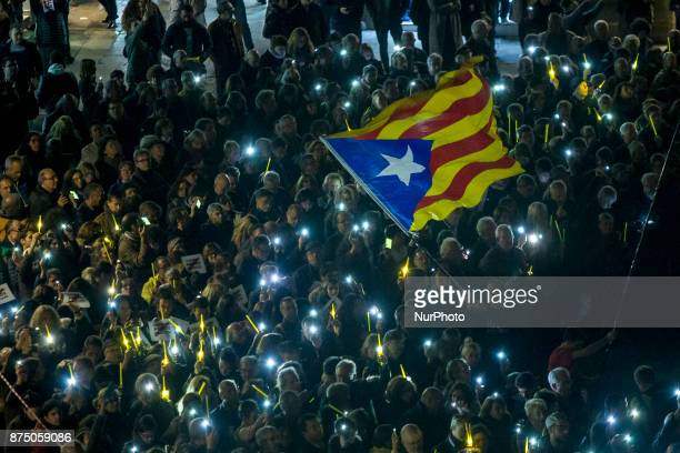Demonstrators turn on mobile phones to illuminate a bond of solidarity with the Catalan proindependence prisoners Proindependence demonstrators...