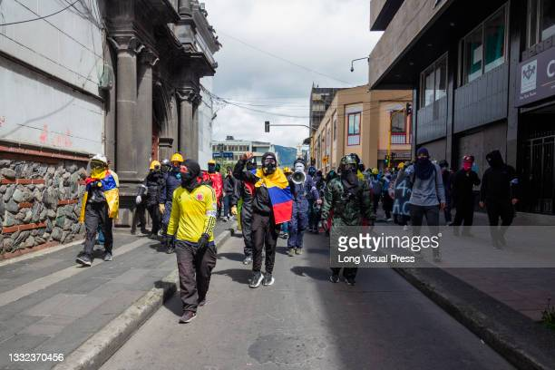 Demonstrators use Colombia's national football team shirts and flags as demonstrations ended in late-night clashes between riot police and...