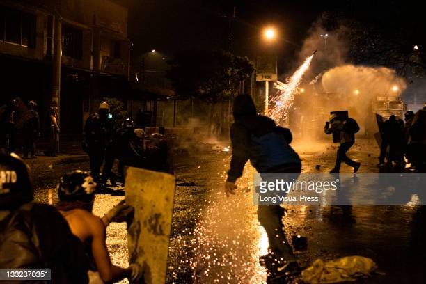 Demonstrators use fireworks against Colombia's riot police as demonstrations ended in late-night clashes between riot police and Demonstrators as...