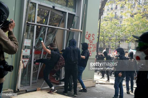 Demonstrators vandalise a bank as they take part in the annual May Day protests on May 01 2019 on Boulevard SaintMarcel Paris France More than 7400...