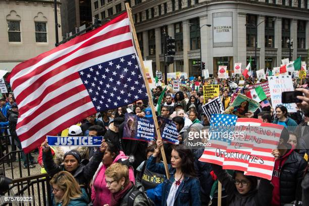 Demonstrators walk into Daley Plaza during a May Day march in Chicago on May 1 2017 Thousands gathered for May Day also known as International...