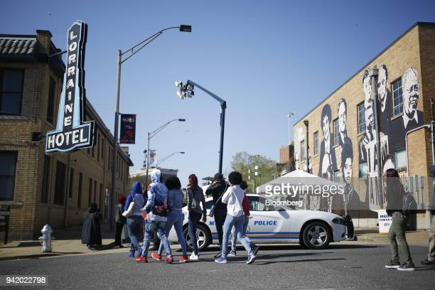 Demonstrators walk toward the National Civil Rights Museum at the former Lorraine Motel during an event commemorating the 50th anniversary of the...