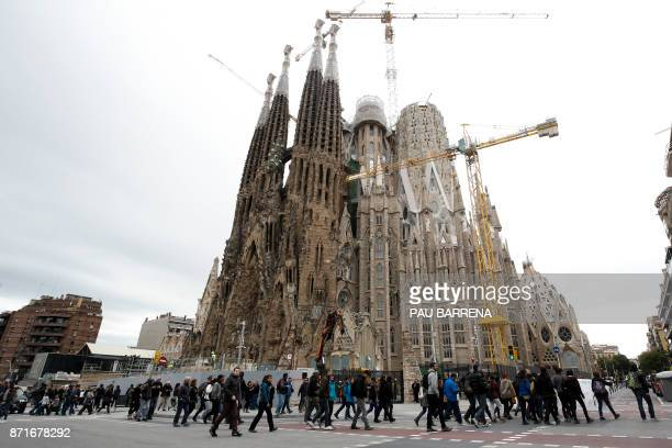 Demonstrators walks near the the Sagrada Familia basilica in Barcelona on November 8 2017 during a regionwide strike called by a proindependence...