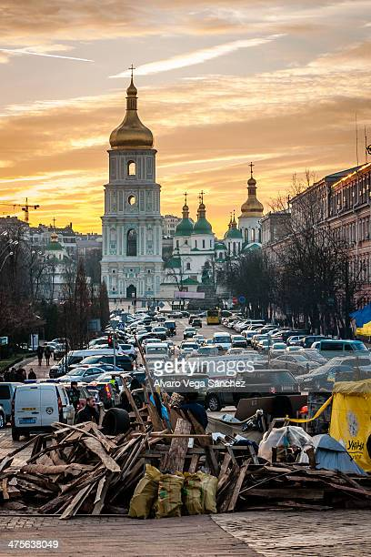 CONTENT] Demonstrators watch the sunset in a barricade in central Kiev Ukraine This barricade was set up to protect the entrance to the St Michael...