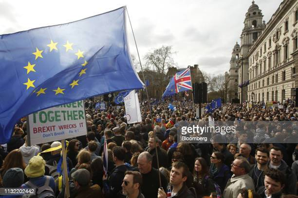 Demonstrators wave a large European Union flag as they stand on Parliament Square during the antiBrexit People's Vote rally in London UK on Saturday...