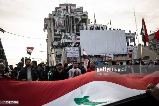 Demonstrators wave a large flag in Tahrir Square on Nov. 22, 2019 in Baghdad, Iraq. Thousands of demonstrators have occupied Baghdad's center Tahrir...
