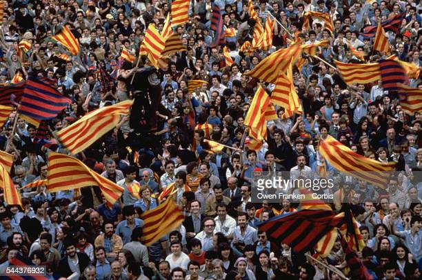 Demonstrators wave Catalan flags in front of the city hall in Barcelona Spain   Location Barcelona Spain