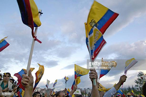 Demonstrators wave Ecuadoran flags during a rally against President Lucio Gutierrez at a place known as Cruz del Papa 19 April 2005 in Quito...