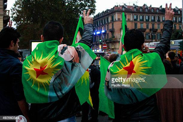 Demonstrators wave flags and bring placards against the Turkish President Erdogan and the attack in Turkey with 87 dead and over 200 injured on...