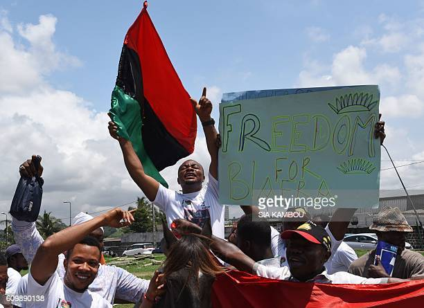 Demonstrators wave flags and hold a sign reading 'Freedom for Biafra' during a protest calling for the release of proBiafra leader Nnamdi Kanu on...