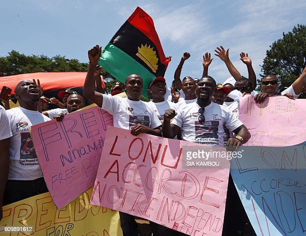 Demonstrators wave flags and hold a sign reading 'The United Nations grants our independence' during a protest calling for the release of proBiafra...