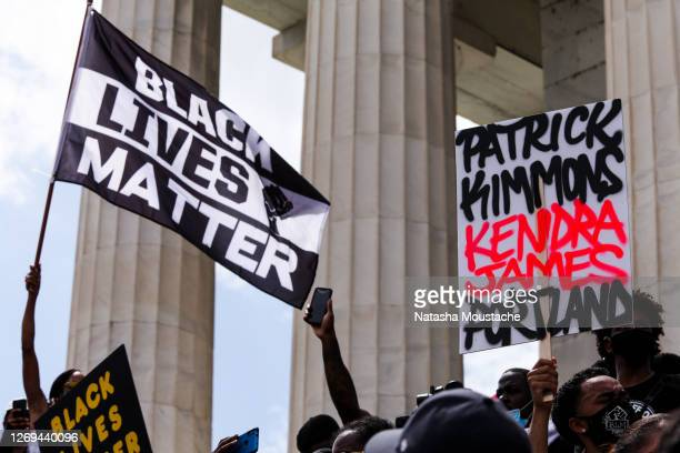 Demonstrators wave flags and hold signs in support of Black Lives Matter during the Commitment March at the Lincoln Memorial on August 28, 2020 in...