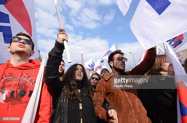 Demonstrators wave flags and shout anti government slogans. Greek PAME union organised a demonstration in Syntagma square against the Greek...