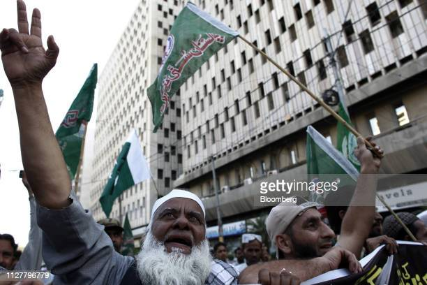 Demonstrators wave flags during an antiIndia protest in Karachi Pakistan on Wednesday Feb 27 2019 Pakistani fighter jets have shot down two Indian...