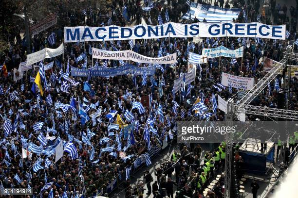 Demonstrators wave Greek national flags during a demonstration February 4, 2018 in Athens, Greece. Protesters gathered in the Greek capital for a...