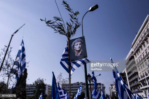 Demonstrators wave Greek national flags during a demonstration February 4 2018 in Athens Greece Protesters gathered in the Greek capital for a rally...