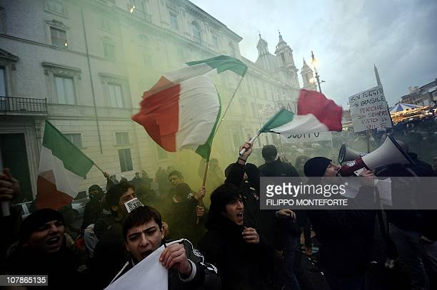 Demonstrators wave Italian flags in front of Brazil's embassy to protest Brazilian President Lula's refusal to extradite ex-militant Cesare Battisti...