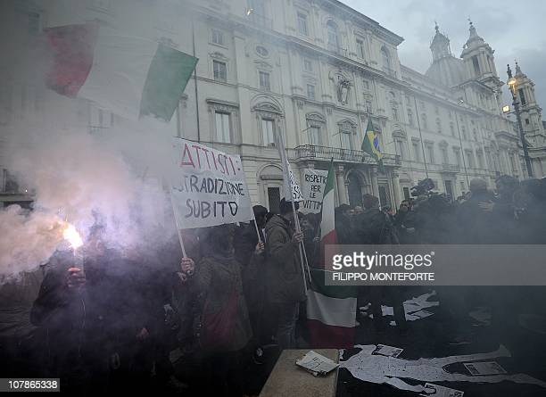 Demonstrators wave Italian flags in front of Brazil's embassy to protest Brazilian President Lula's refusal to extradite exmilitant Cesare Battisti...