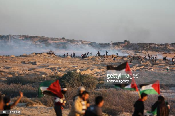Demonstrators wave Palestinian flags during a protest against Israeli blockade over Gaza on December 10 2018 at the coast of Gaza Strip Gaza
