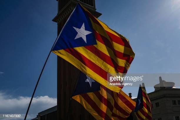 Demonstrators wave proindependence Catalan Estelada flags during Catalonia's national day known as Diada Nacional de Catalunya at Plaza Espana in...