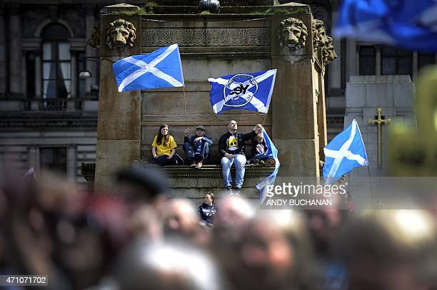 Demonstrators wave Saltire flags the national flag of Scotland during a proindependence rally in Glasgow Scotland on April 25 urging the Scots to put...