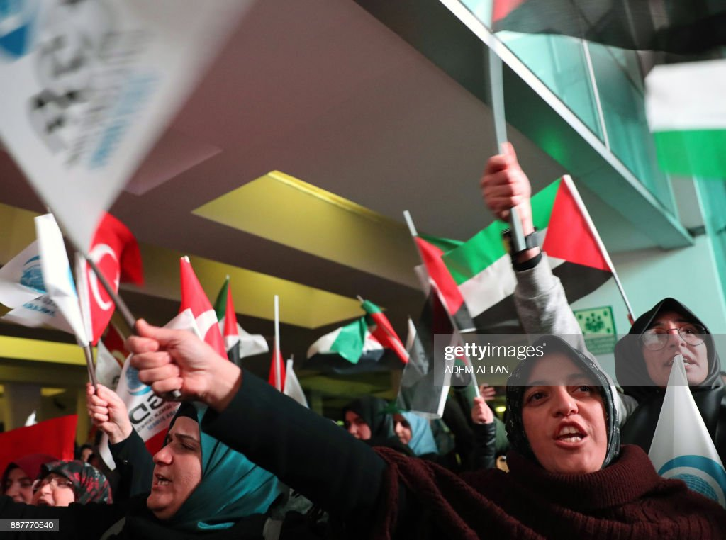 Demonstrators wave Turkish and Palestinian flags as they shout slogans during a protest near the U.S. Embassy in Ankara on December 7, 2017, against the U.S. intention to move its embassy to Jerusalem and to recognize the city of Jerusalem as the capital of Israel. / AFP PHOTO / Adem ALTAN