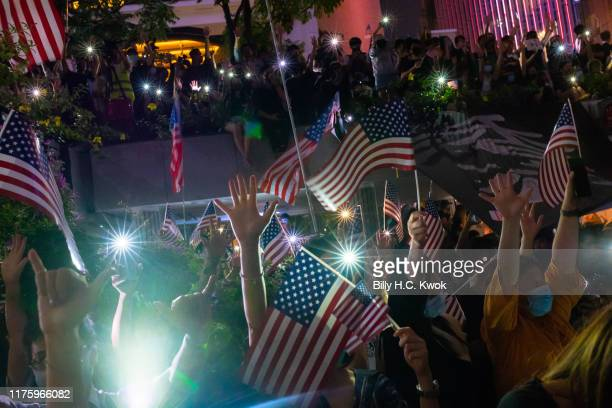 Demonstrators wave US national flags during a rally in support of the Hong Kong Human Rights and Democracy Act on October 14 2019 in Hong Kong China...