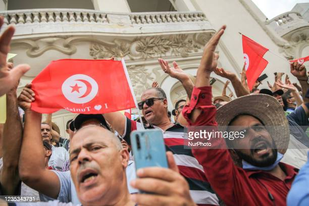 Demonstrators waving Tunisian flags, gesture as they shout dégage , during a demonstration held in the capital Tunis, Tunisia, on September 18 to...