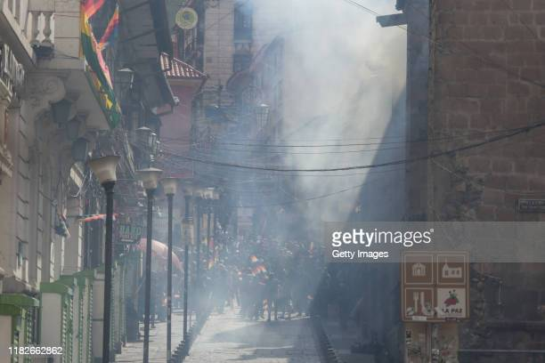 Demonstrators waving Whipala flags march among a cloud of tear gas during a protest on November 15 2019 in La Paz Bolivia Morales flew to Mexico...
